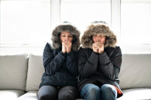 cold-man-and-woman-in-parkas