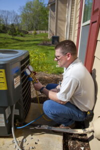 technician-checking-on-ac-pressure